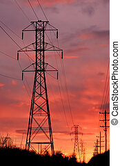 Powerline tower on sunset - Silhouette powerline tower on ...