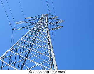 Powerline tower seen from below against blue sky