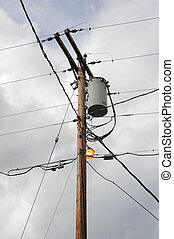 Powerline utility pole. - Powerline utility pole high in the...