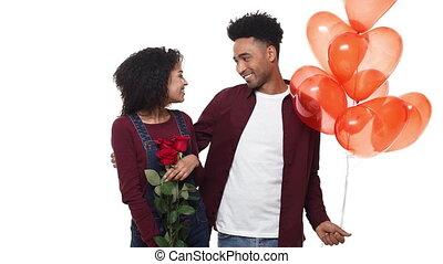 powolny ruch, młody, afrykanin amerykański człowiek, niespodzianka, jego, sympatia, z, róża, i, serce, balloon, na, urodziny, albo, anniversary.