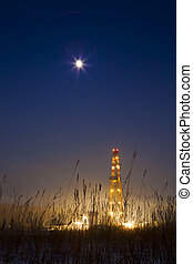 pozo de petróleo, en, el, nevoso, paisaje, encendido para arriba, en, night.