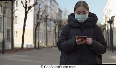 Pportrait of woman in protective medical mask using smart ...