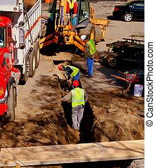 pracownicy zbudowania, wykopując