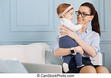 Practical experienced specialist enjoying her maternity leave