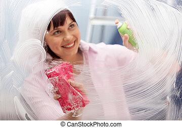 Practical woman - Portrait of a woman washing window