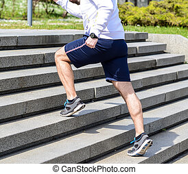 Practice - Close up of young man running up the stairs