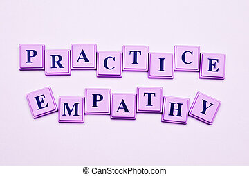 Practice Empathy spelled out in colored blocks