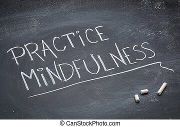 practice mindfulness text on blackboard