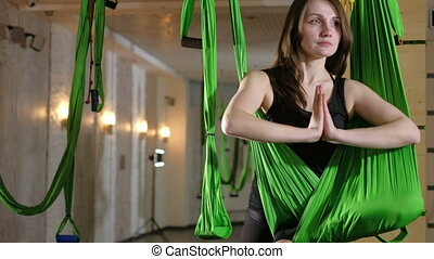 Practice of anti gravity fly yoga with hammock.