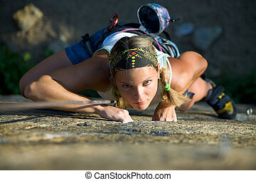 Practice - Vertical image of woman doing exercise on the ...