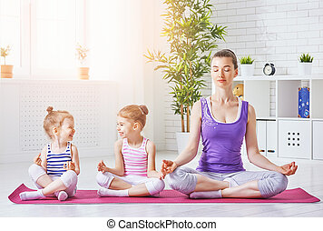 practice yoga - beautiful girl is engaged in yoga with her...
