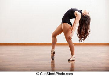 Practicing a ballet dance routine - Sexy ballerina...