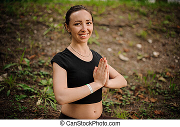 Practicing of yoga outdoors in forest