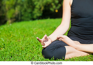 Practicing Yoga on a Grass
