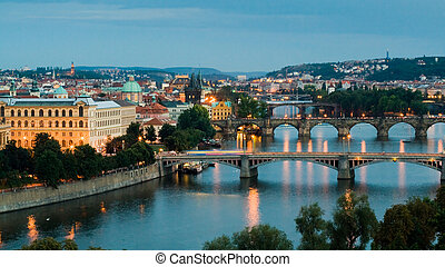 Panorama of Prague (Czech Republic) on sunset. Bridges of the Vltava River