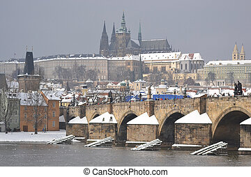 The Prague Castle and the Charles Bridge at winter in Prague, Czech Republic.