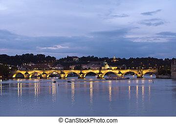 Prague at night with Charles Bridge(Karluv Most) over Vltava river