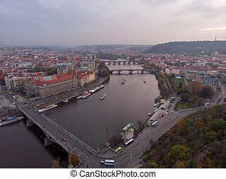 Prague bridges aerial view at autumn in twilight cloudy day, blue hour
