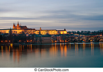Prague castle and Vltava river at dusk