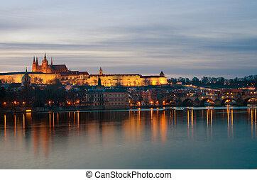 Prague castle and Vltava river at dusk