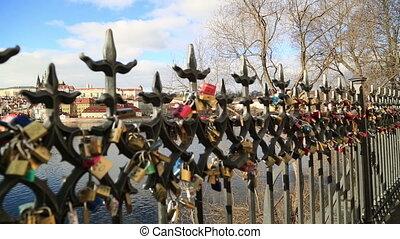 Prague castle behind the Love locks - Love locks at bridge...