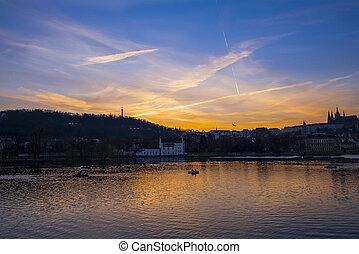 PRAGUE / CZECH REPUBLIC - MARCH 29, 2019: Beautiful sunset on the Vltava river. Prague city, Czech Republic