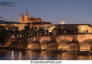 Prague Cityscape at Night with Saint Vitus Cathedral and Charles Bridge in a Nostalgic Vintage Look
