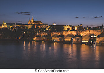Prague Cityscape at Night with Saint Vitus Cathedral and Charles Bridge
