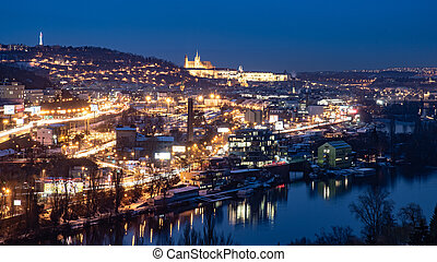 Prague cityscape by night with illuminated Prague Castle and Vltava River