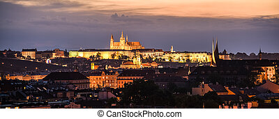 Prague cityscape by night with illuminated Prague Castle