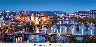 Prague, Czech Republic bridges panorama. Charles Bridge and Vltava river at night