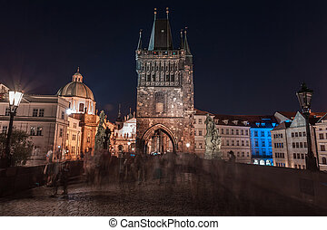 Prague, Czech Republic. Charles Bridge (Karluv Most) and Old Town Tower at night.