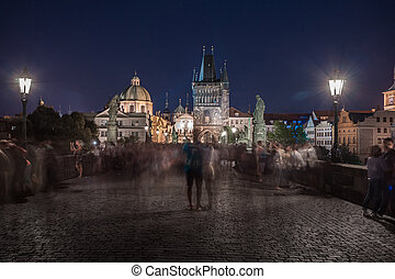 Prague, Czech Republic. Charles Bridge (Karluv Most) and Old Town Tower at night. Travel.