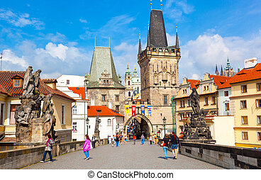 PRAGUE, CZECH REPUBLIC - JUNE 11: Tourists on Charles Bridge, June 11, 2012, Prague, Czech Republic. Annually Prague is visited by more than 3,5 million tourists.
