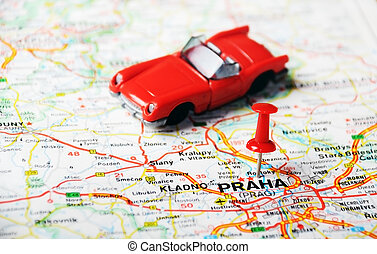 Close up of Prague, Czech Republic map with red pin and auto - Travel concept