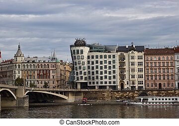 PRAGUE, CZECH REPUBLIC - NOVEMBER 4, 2012: The Dancing House, the Nationale-Nederlanden building in Prague, Czech Republic. View from the river Vltava