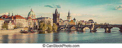 Prague, Czech Republic panorama with historic Charles Bridge and Vltava river. Vintage