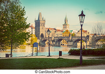 Prague, Czech Republic skyline with historic Charles Bridge and Vltava river. Vintage