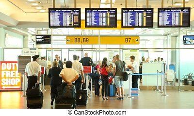 People pass passport control on exit to gates of Ruzyne airport