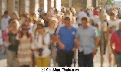 PRAGUE - JUNE 15: People walking down the street in the...