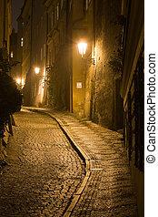 Old lane in Prague Little Quarter at night lighting.