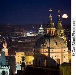 Prague night scenery with moon - Full moon rising behind the...