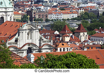 Prague - St. Nicholas Church in Lesser Town and city panorama