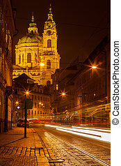 Prague street with Saint Nicolas church