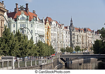 Prague - waterfront with historic buildings and bridge