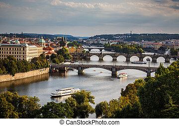 Prague with its splendid bridges over the Vltava river, city sunset panorama, Czech Republic