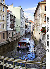 Prague's canal - Narrow canal and boat at Prague. Czech ...