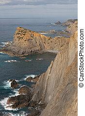 Praia da Arrifana beach sea cliffs in Costa Vicentina, ...