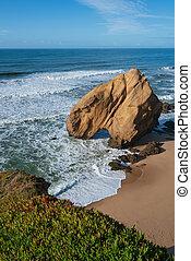 Praia de Santa Cruz beach rock boulder, in Torres Vedras, Portugal