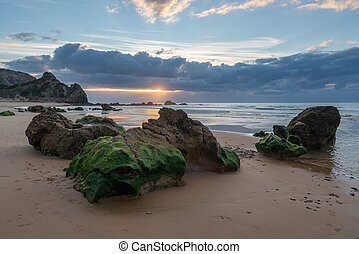 Praia do amado beach at sunset in Costa Vicentina, Portugal